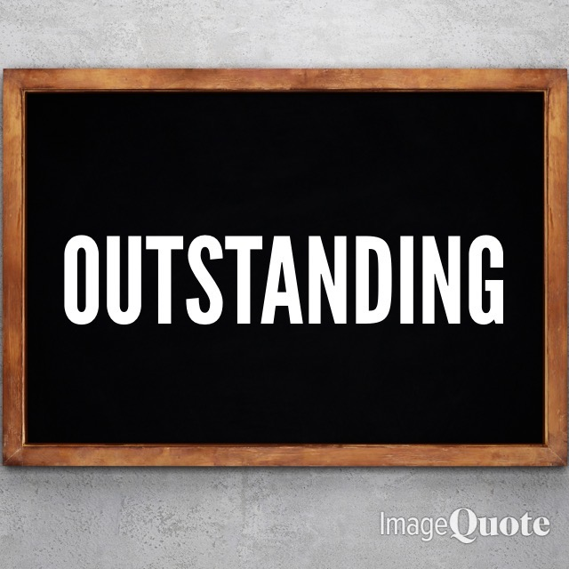 A chalkboard with the word outstanding on it