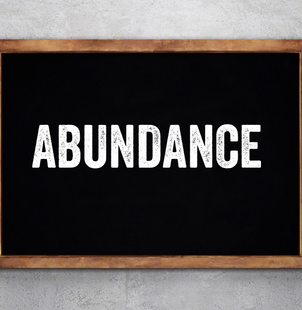 Chalkboard with the word Abundance on it.