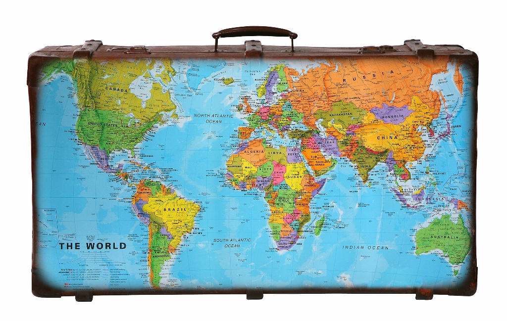A suitcase with a map of the world on it.