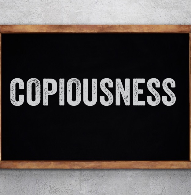 Chalk board with the word copiousness on it.