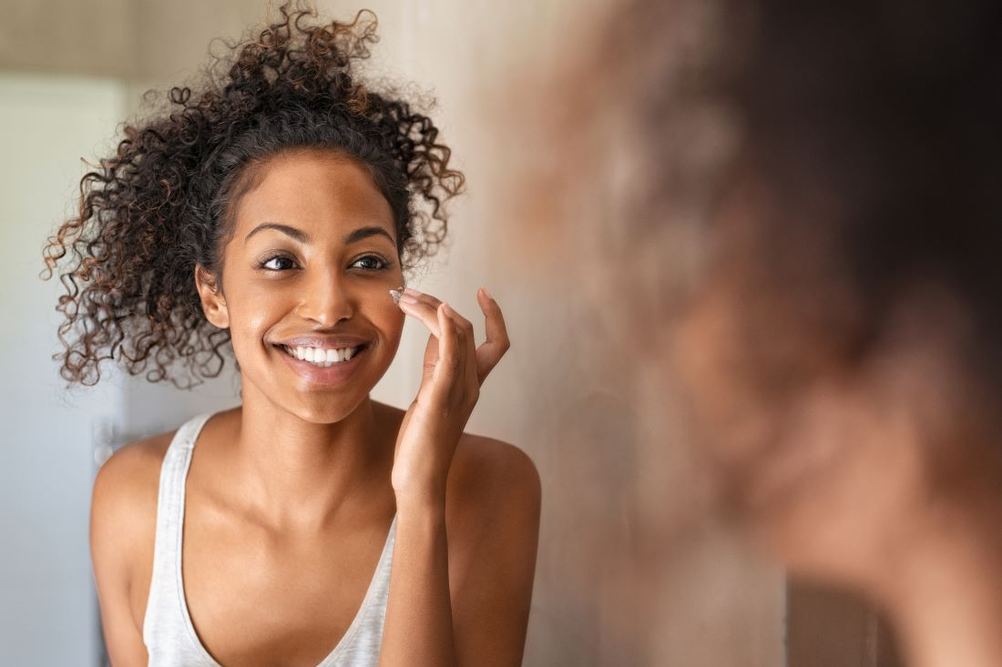Image of a woman applying cbd skin cream
