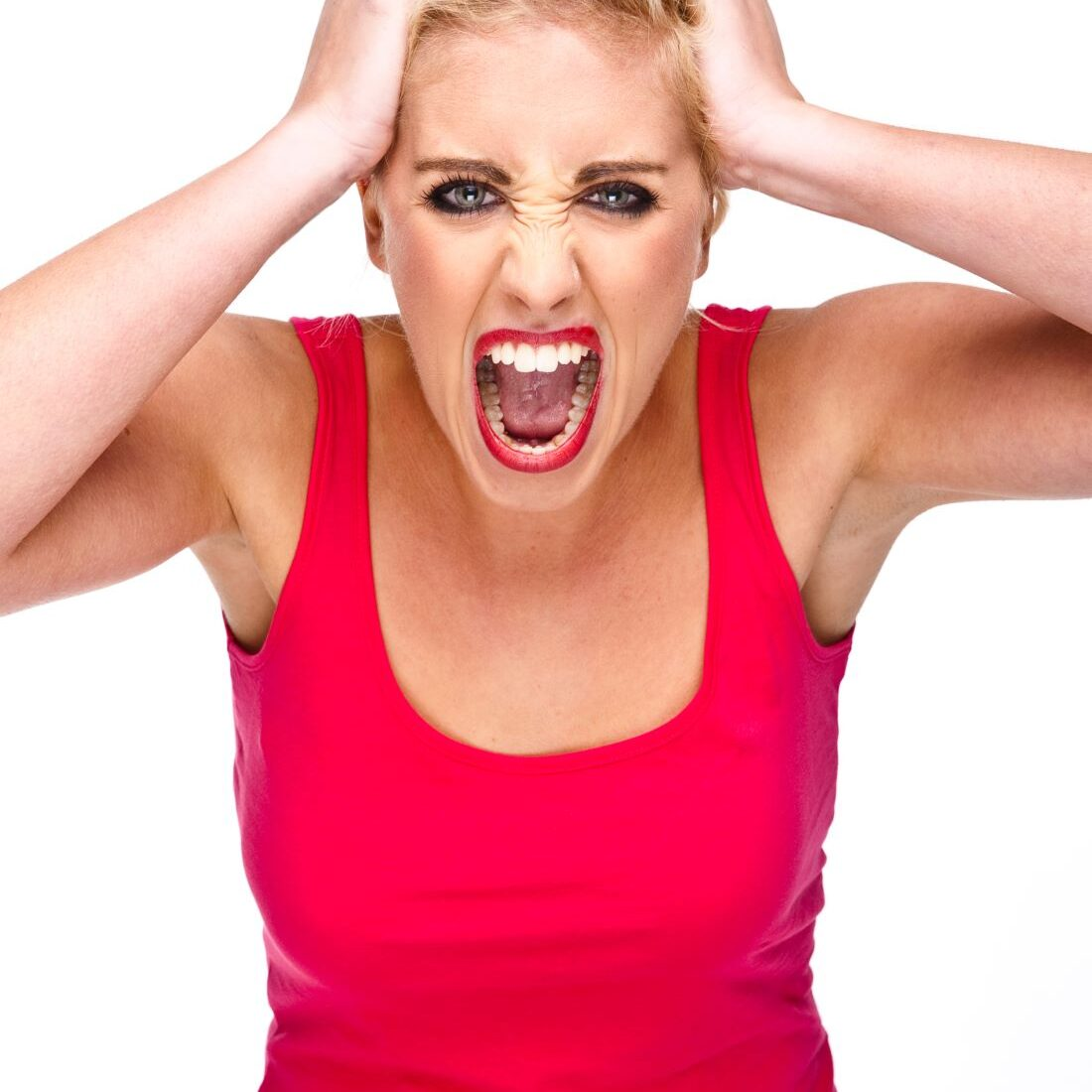 Image of a frustrated woman to demonstrate frustration with manifestation