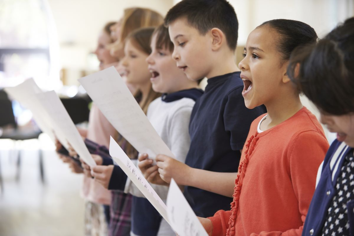 Kids in choir singing accentuate the positive