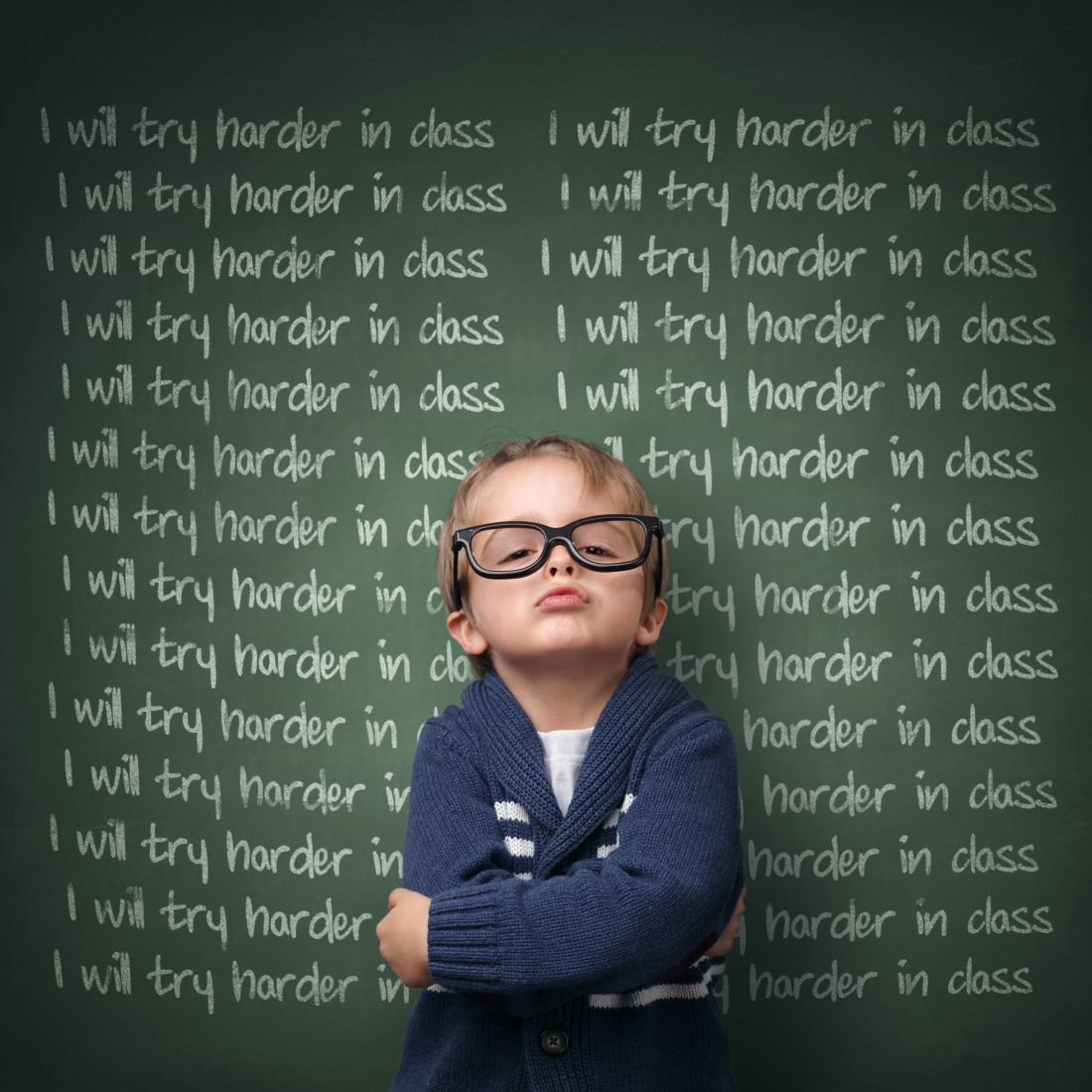 A schoolboy writing lines