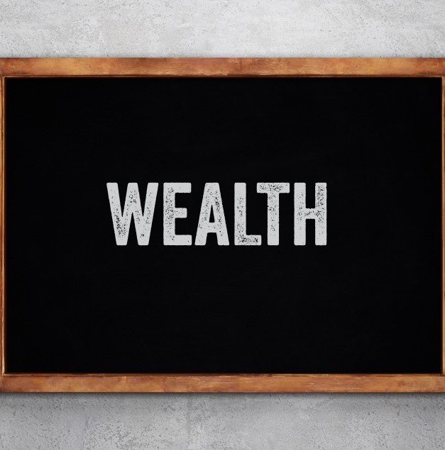 Image of the word wealth on a chalkboard