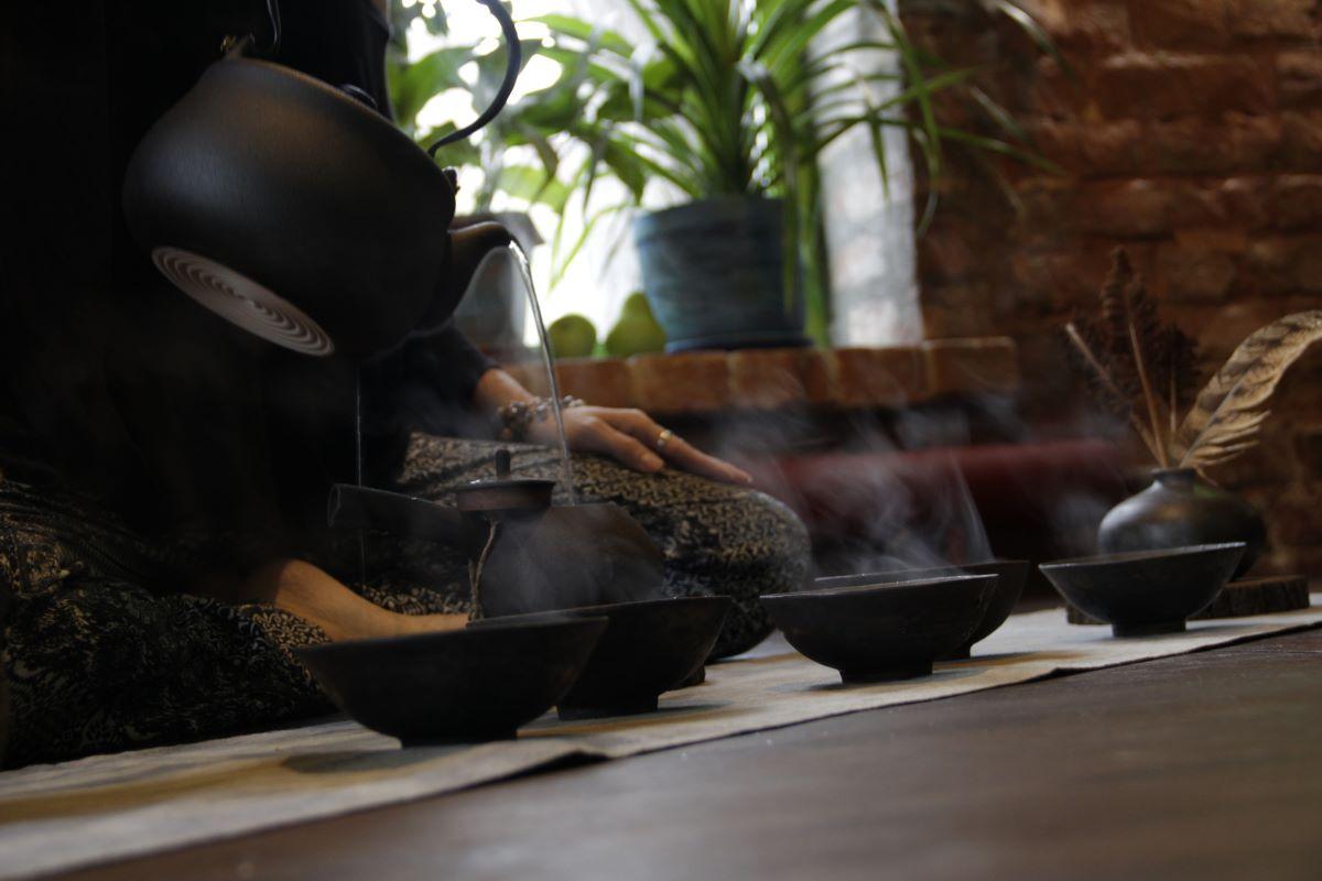 A woman serving tea