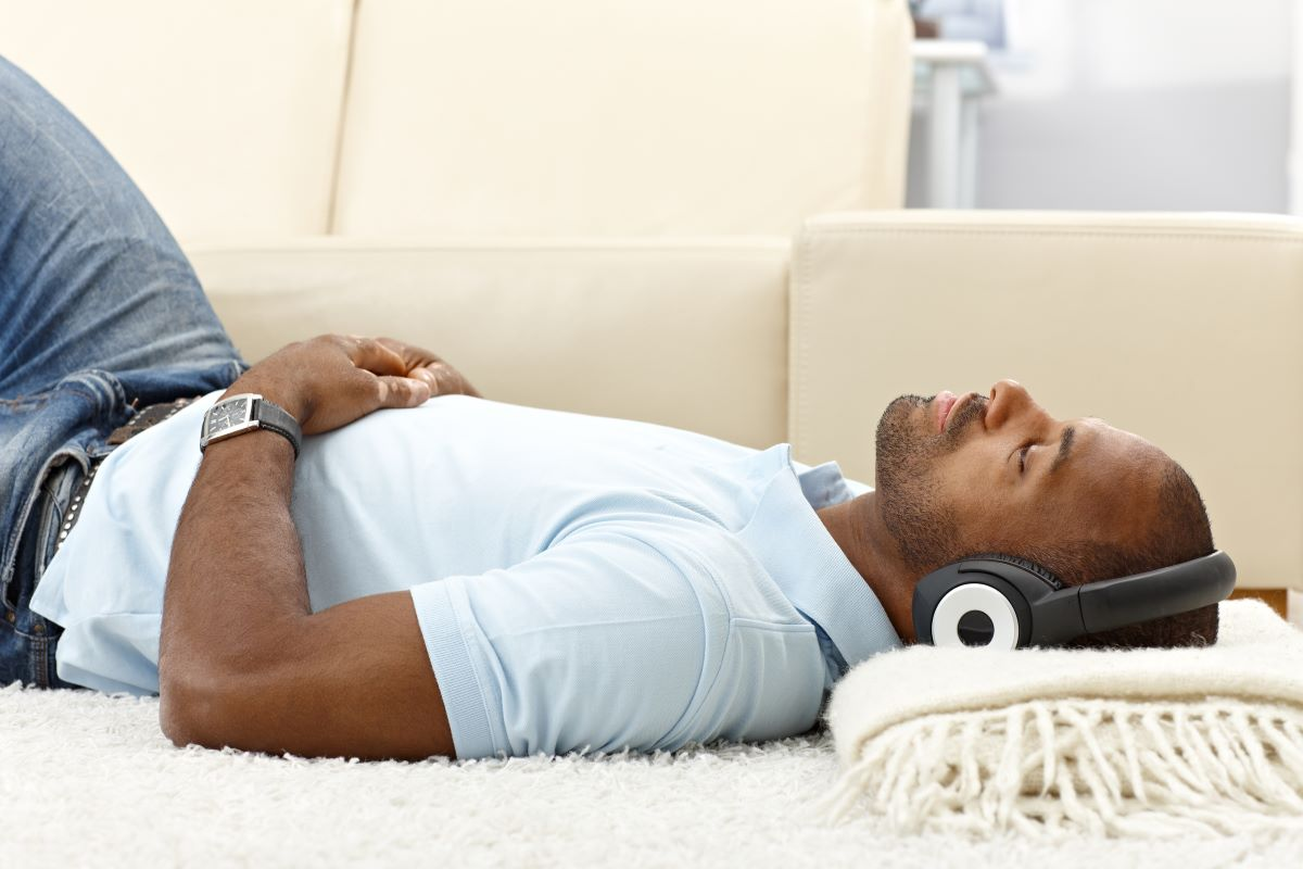 A man relaxing and listening to music