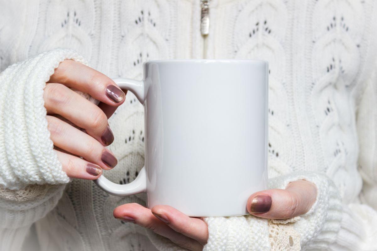 lady holding a mug to advertise Brookstone mug