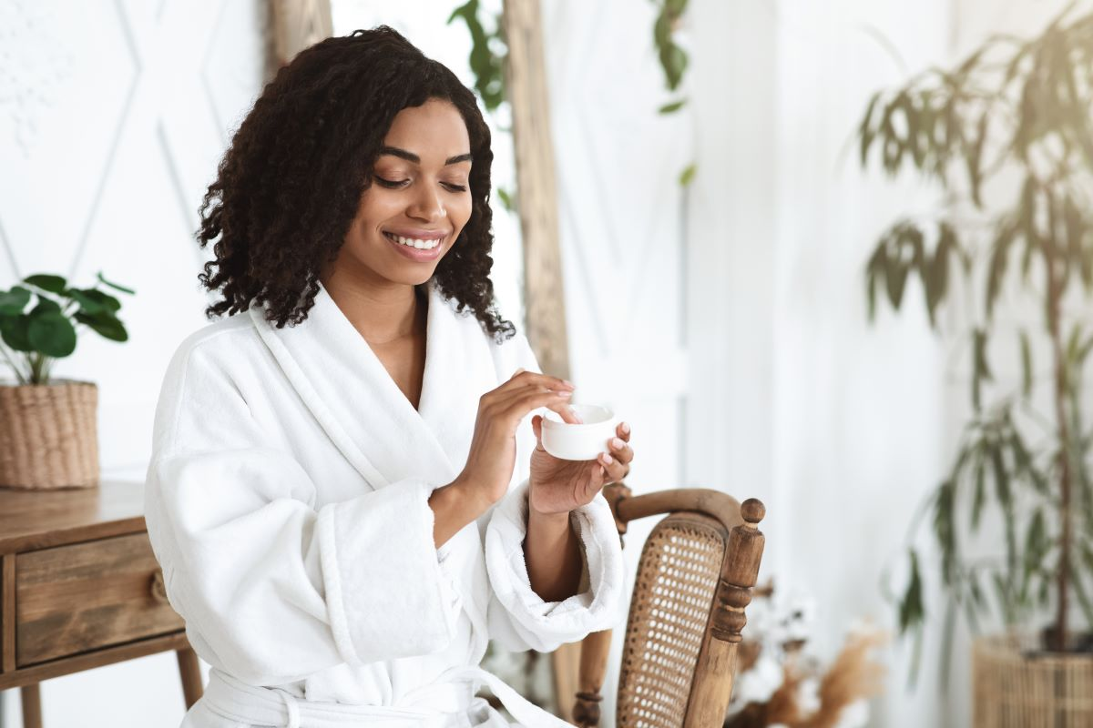 a lady performing using skincare products